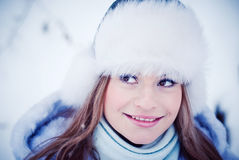 Beautiful girl in a winter snowy park Stock Image