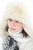Beautiful girl in a winter white cap and a jumper on white.  Royalty Free Stock Photos