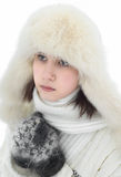 Beautiful girl in a winter white cap and a jumper on white.  Royalty Free Stock Image