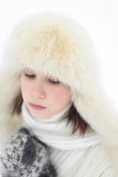 Beautiful girl in a winter white cap and a jumper on white.  Royalty Free Stock Photography