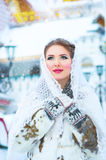 Beautiful girl in the winter. Beautiful girl with white headscarf in the winter Stock Photography