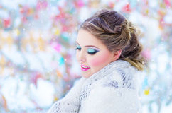 Beautiful girl in the winter. Beautiful girl with white headscarf in the winter Stock Images