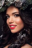 Beauty Fashion Model over Holiday. Beautiful girl with winter wreath. royalty free stock photos