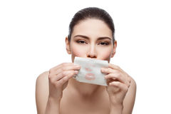 Beautiful girl wiping lips with tissue Stock Photo