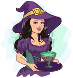 Beautiful girl witch holds potion cup on a tray Stock Image