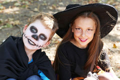 Beautiful girl witch and little boy Royalty Free Stock Photos