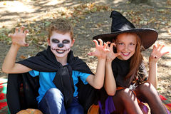 Beautiful girl witch and little boy. In the park, outdoors Stock Photography