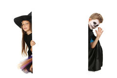 Beautiful girl witch and little boy Stock Photos