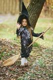 Beautiful girl witch. little girl in which costume celebrate Halloween outdoor and have a fun. Kids trick or treating. Beautiful girl witch. little girl in royalty free stock images