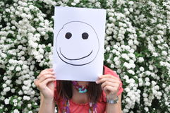 Beautiful Girl With A Sheet Of Paper Over Th Stock Photography