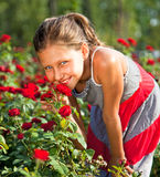 Beautiful Girl With Blue Eyes In Garden Stock Photo