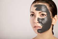Free Beautiful Girl With Clay Mask On Her Face Stock Image - 65685011