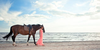 Beautiful Girl With Horse On Seacoast Royalty Free Stock Image