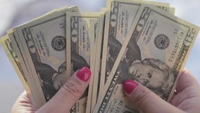 Free Beautiful Girl With Pink Nails, Holds A 20 Dollar Denominations In His Hands And Count Them, 4k., 3840x2160 Stock Photography - 86684052