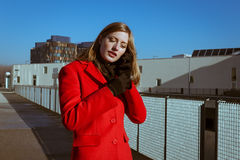 Beautiful Girl With Red Coat Talking On Phone Stock Images