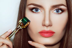 Beautiful girl woman in spa salon. Mesotherapy. Beautiful girl woman in spa salon,facial rejuvenation procedure.Visit a beautician.Hyaluronic acid rejuvenation Royalty Free Stock Image