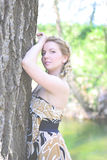 Beautiful girl in wood by summer Royalty Free Stock Photography