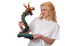 Beautiful girl with a wooden dragon Stock Photography