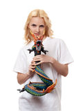 Beautiful girl with a wooden dragon. Isolated on a white background stock photos
