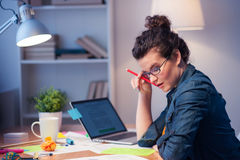 Beautiful girl is working hard with documents Royalty Free Stock Images