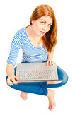 Beautiful girl working at laptop on the floor Royalty Free Stock Images