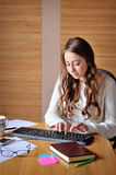 Beautiful girl working in the office at the computer Stock Photo