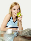 Beautiful girl working using a laptop Stock Images