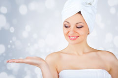 A beautiful girl wrapped in the bathtowel Royalty Free Stock Images