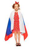 Beautiful girl wrapped in a flag of Russia. Beautiful curly-haired girl with funny headband in red polka dot dress wrapped in  flag of Russian Federation Stock Images