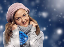 Beautiful girl wrapped in a scarf. Stock Photos