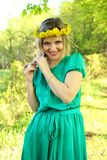 Beautiful girl with a wreath of dandelions Stock Images