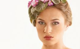 Beautiful girl with a wreath of flowers Royalty Free Stock Image