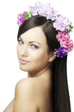 Beautiful girl with a wreath of flowers Royalty Free Stock Photo