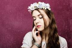 Beautiful girl with a wreath of flowers. Beautiful brunette girl with a wreath of flowers Royalty Free Stock Photography