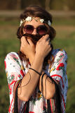Beautiful girl with a wreath of flowers covers the face hair Outdoors Stock Images