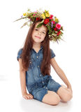 Beautiful girl with a wreath of flowers on her head. Royalty Free Stock Images