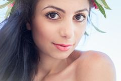 Beautiful girl with a wreath of flowers on her head Stock Photo