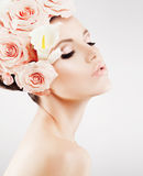 Beautiful girl with a wreath of flowers. Beautiful lady with a wreath of flowers. Pink roses Stock Photography