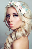 Beautiful girl with a wreath of flowers. Beautiful lady with a wreath of flowers. Pink roses Stock Images