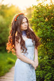 Beautiful girl with a wreath on the head of cherries Royalty Free Stock Photo