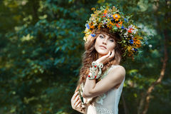 Beautiful girl with wreath on the head of  field flowers. Stock Photo