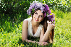Beautiful girl with wreath of lilac flowers Stock Image