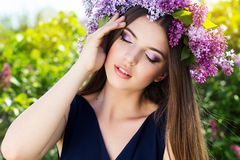 Beautiful girl with wreath of lilac flowers Stock Images