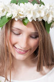 Beautiful girl  with a wreath of white flowers Stock Images