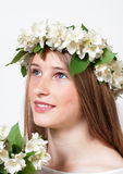 Beautiful girl in a wreath of white flowers Royalty Free Stock Photo
