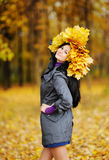 Beautiful girl with a wreath of yellow leaves on the head on a b Royalty Free Stock Photo