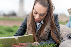 Beautiful girl writing in a book Royalty Free Stock Photo