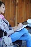 Beautiful girl writing in diary with coffee Royalty Free Stock Photo