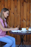Beautiful girl writing in her notebook Royalty Free Stock Image