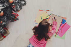Beautiful girl writing letter to santa, wait for christmas Royalty Free Stock Photography